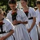 Girls fold their hands in prayer during the annual Corpus Christi procession on Lake Staffelsee near Seehausen, Germany, June 15, 2017. EPA/PHILIPP GUELLAND