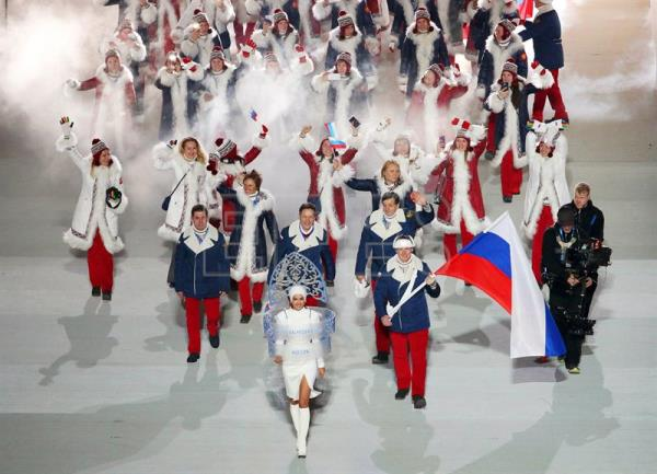 Team Russia with flag bearer Alexander Zubkov (C-R) during the Opening Ceremony of the Sochi 2014 Olympic Games at the Fisht Olympic Stadium in Sochi, Russia, Feb. 7, 2014. EPA-EFE FILE/BARBARA WALTON
