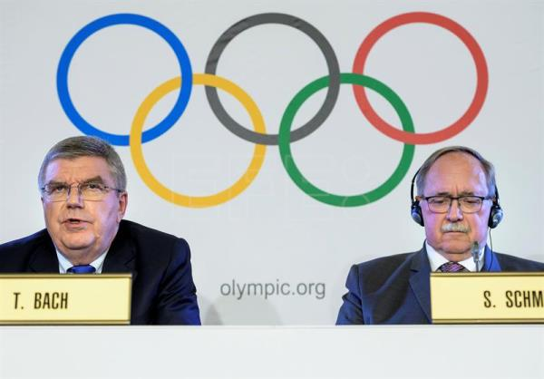 International Olympic Committee (IOC) President Thomas Bach (L) from Germany, and Samuel Schmid (R), President of the IOC Inquiry Commission and former President of Switzerland, attend a press conference after an Executive Board meeting in Lausanne, Switzerland, Dec. 5, 2017. EPA-EFE/JEAN-CHRISTOPHE BOTT