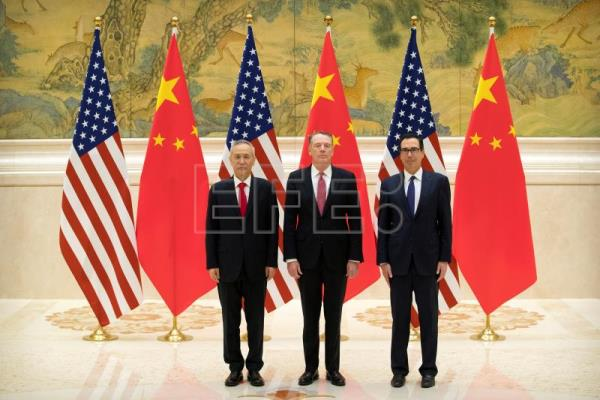 United States Trade Representative Robert Lighthizer (L), Chinese Vice Premier and lead trade negotiator Liu He (C) and United States Secretary of the Treasury Steven Mnuchin (R) pose for a photo before the opening session of trade negotiations at the Diaoyutai State Guesthouse in Beijing, China, Feb. 14, 2019. EPA-EFE/MARK SCHIEFELBEIN / POOL