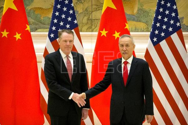 United States Trade Representative Robert Lighthizer (L) and Chinese Vice Premier and lead trade negotiator Liu He (R) shake hands as they pose for a photo before the opening session of trade negotiations at the Diaoyutai State Guesthouse in Beijing, China, Feb. 14, 2019. EPA-EFE/MARK SCHIEFELBEIN / POOL