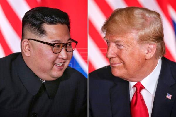 North Korean leader Kim Jong-un (L) and US President Donald J. Trump (R) react during their first one-on-one meeting, part of the historic summit, at the Capella Hotel on Sentosa Island, Singapore, Jun. 12, 2018 EPA-EFE/FILE/KEVIN LIM/THE STRAITS TIMES/SINGAPORE OUT