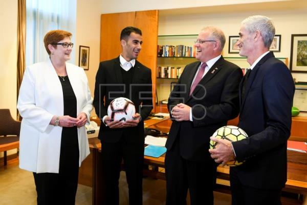 Footballer and refugee Hakeem al-Araibi (2-L), Australian Prime Minister Scott Morrison (2-R), Former Socceroo Craig Foster (R) and Australian Foreign Minister Marise Payne (L) speak during a meeting at Parliament House in Canberra, Australia, Feb. 14, 2019. EPA-EFE/LUKAS COCH AUSTRALIA AND NEW ZEALAND OUT
