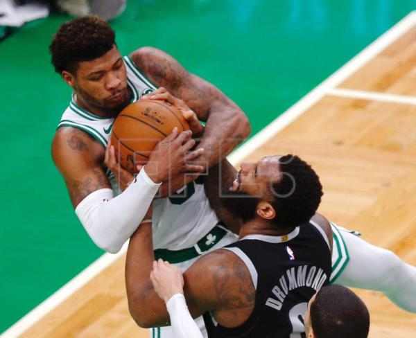 Boston Celtics guard Marcus Smart (L) and Detroit Pistons center Andre Drummond (R) battle for the loose ball during the match between the Detroit Pistons and the Boston Celtics at TD Garden in Boston, Massachusetts, USA, Feb. 13, 2019. EPA-EFE/CJ GUNTHER SHUTTERSTOCK OUT