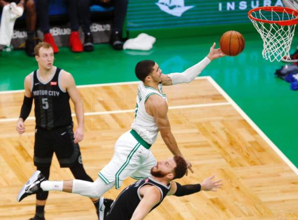 Boston Celtics forward Jayson Tatum (C) goes over Detroit Pistons forward Blake Griffin (R) for a shot during the match between the Detroit Pistons and the Boston Celtics at TD Garden in Boston, Massachusetts, USA, Feb. 13, 2019. EPA-EFE/CJ GUNTHER SHUTTERSTOCK OUT