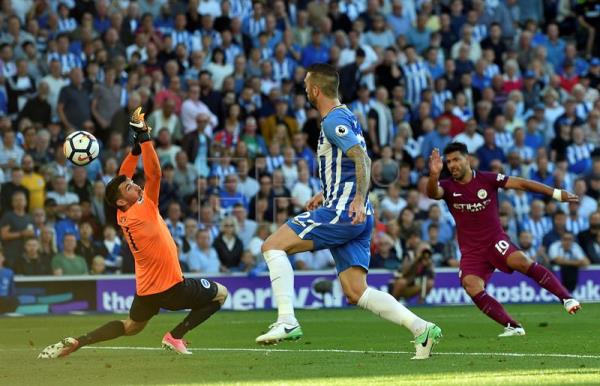 Manchester City's Sergio Aguero (R) scores during the Premier League match between Brighton and Manchester City at the Amex Stadium, Brighton, East Sussex, Britain, 12 August 2017. EPA/GERRY PENNY EDITORIAL USE ONLY. No use with unauthorized audio, video, data, fixture lists, club/league logos or 'live' services. Online in-match use limited to 75 images, no video emulation. No use in betting, games or single club/league/player publications