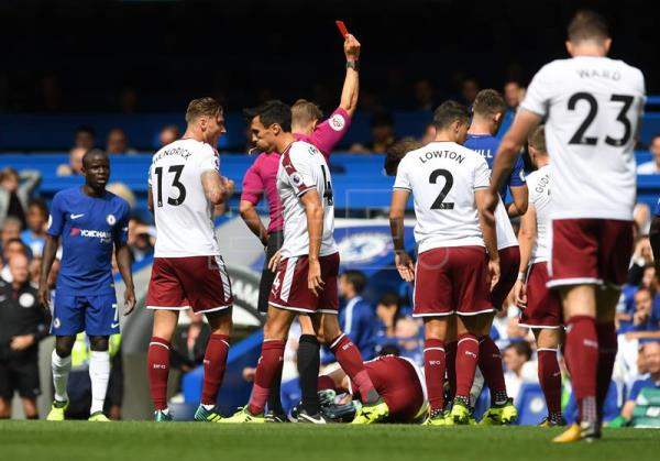 Chelsea Gary Cahill (2-R) receives a red card during the English Premier league game between Chelsea and Burnley at Stamford Bridge stadium in London, Britain, 12 August 2017. EPA/FACUNDO ARRIZABALAGA EDITORIAL USE ONLY. No use with unauthorized audio, video, data, fixture lists, club/league logos or 'live' services. Online in-match use limited to 75 images, no video emulation. No use in betting, games or single club/league/player publications