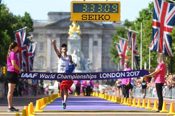 France's Yohann Diniz celebrates while crossing the finish line to win the men's 50km Race Walk at the London 2017 IAAF World Championships in central London, Britain, 13 August 2017. EFE