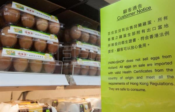 A customer notice advising that eggs on sale in a supermarket in Hong Kong are safe for consumption, Hong Kong, China. EFE
