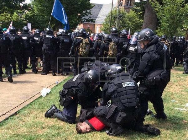A handout photo made available by the Virginia State Police shows police arresting a protester following a declaration of unlawful assembly at Emancipation Park in Charlottesville, Virginia, USA, 12 August 2017. EPA/Virginia State Police/ HANDOUT HANDOUT EDITORIAL USE ONLY/NO SALES