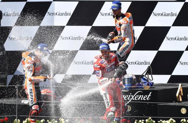 Italian MotoGP rider Andrea Dovizioso (C) of the Ducati Team celebrates his victory with second placed Spaniard Marc Marquez (L) of Repsol Honda Team and third placed Spaniard Dani Pedrosa (top) of the Repsol Honda Team in the Motorcycling Grand Prix of Austria at the Spielberg Ring in Spielberg, Austria, 13 August 2017. EFE