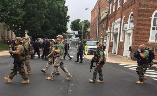A handout photo made available by the Virginia State Police shows heavily-armed men in camouflage clothing and tactical gear marching at the Charlottesville rally in Charlottesville, Virginia, USA, 12 August 2017. EPA/Virginia State Police/ HANDOUT HANDOUT EDITORIAL USE ONLY/NO SALES
