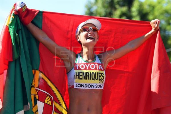 Portugal's Ines Henriques celebrates after winning the women's 50km Race Walk in a new World Record Time at the London 2017 IAAF World Championships in central London, Britain, 13 August 2017. EFE