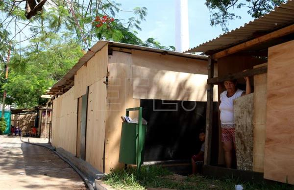"A woman damaged by the rains remains outside an improvised house in a square in Asuncion, Paraguay, Nov. 12, 2018. There are 6,000 families that have been evacuated from the ""marshes"" (marginal areas) of Asunción due to flooding of the Paraguay River, which today reached 5.98 meters and is expected to reach 7. meters in December, authorities said. EPA/EFE/ANDRES CRISTALDO"
