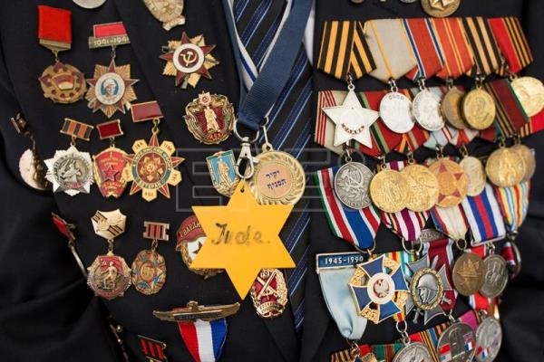 A close up shot showing the medals of a Russian Israeli World War II veteran, who served as Russian soldiers from the Soviet Union, is seen at a memorial ceremony at the Yad Vashem Holocaust Museum during the Victory in Europe (VE) Day ceremony in Jerusalem, Israel, May 9, 2017. EPA/ABIR SULTAN