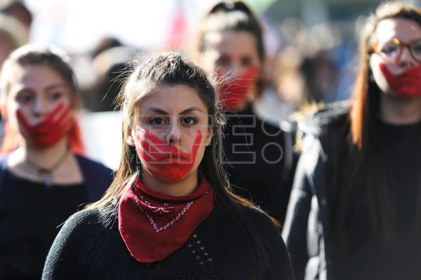 A Chilean woman with her face painted during a demonstration for women's rights, an the end of sexist education and the gender gap, in Santiago, Chile, on June 6, 2018.  EFE-EPA/Alberto Valdes