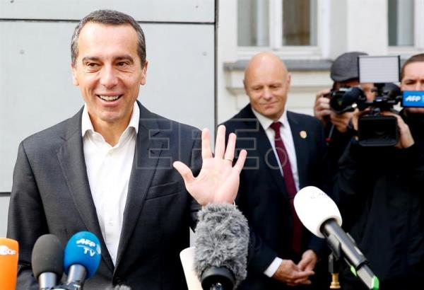 Austrian Chancellor and head of the Social Democratic Party (SPOe) Christian Kern answers media questions after casting his vote in the Austrian Federal Elections in Vienna, Austria, Oct. 15, 2017. EPA-EFE/FLORIAN WIESER