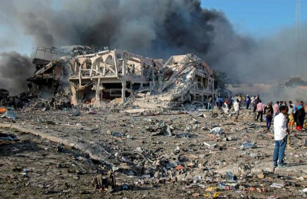 People gather at the scene of a massive explosion in front of Safari Hotel in the capital Mogadishu, Somalia. EFE