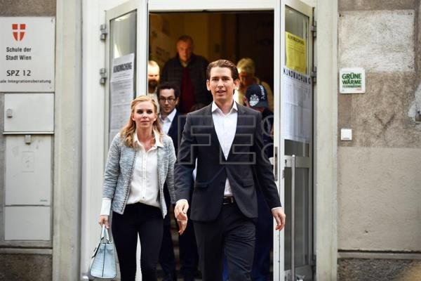 Austrian Foreign Minister Sebastian Kurz (R), the leader and top candidate of the Austrian Peoples Party (OeVP) and his girlfriend Susanne Thier (L) leave a polling station after casting their votes in the Austrian Federal Elections in Vienna, Austria, Oct. 15, 2017. EPA-EFE/CHRISTIAN BRUNA