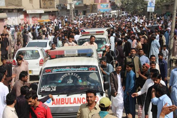 Ambulances carry bodies of victims who were killed in a suicide bomb attack at shrine of Sufi Muslim Saint Lal Shahbaz Qalander, during funeral ceremony in Larkana, Pakistan, 17 February 2017. EPA/WAQAR HUSSEIN
