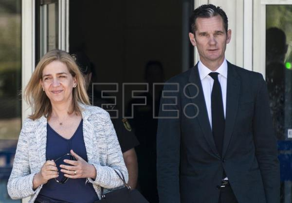 File from June 22, 2016 shows Spain's King Felipe VI's sister Princess Cristina de Borbon and her husband Inaki Urdangarin leaving the Balearic Academy of Public Administration (EBAP). EFE/Cati Cladera