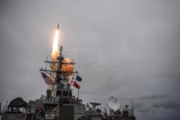 A handout photo file made available by the US Navy on 14 April 2018, shows the Arleigh Burke-class guided-missile destroyer USS Donald Cook (DDG 75) firing a standard missile 3 during an exercise at sea, in the Atlantic Ocean, 15 October 2017. EFE/US NAVY/MC1 THERON J. GODBOLD