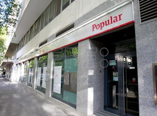 Accionistas del popular recurren en europa la for Oficinas banco popular madrid