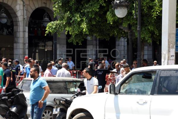 Police officer dead, 8 people injured as twin blasts hit Tunis