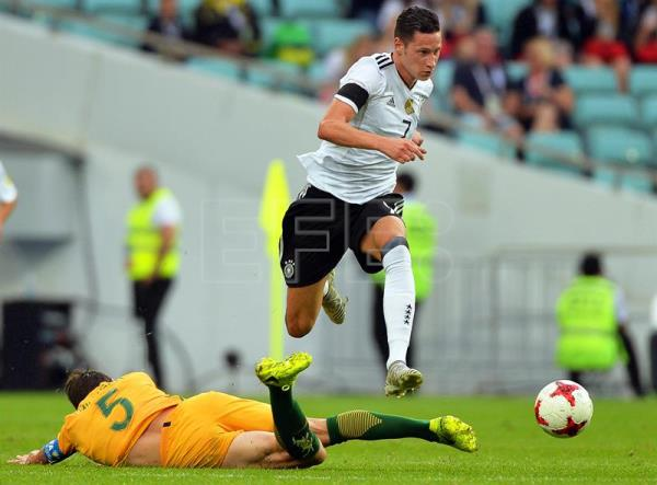 A photo shows Germany's Julian Draxler (R) in action against Australia's Mark Milligan (L) during their FIFA Confederations Cup 2017 group B soccer match at the Fisht Stadium in Sochi, Russia, on June 19, 2017. EPA/PETER POWELL