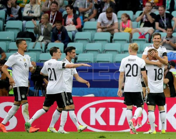 A photo shows Leon Goretzka (up) of Germany celebrates with teammates after scoring the 3-1 lead during the FIFA Confederations Cup 2017 group B soccer match between Australia and Germany at the Fisht Stadium in Sochi, Russia, on June 19, 2017. EPA/ARMANDO BABANI
