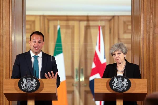 British Prime Minister Theresa May (R) and Irish Taoiseach Leo Varadkar (L) during a press conference after their meeting at 10 Downing Street in London, United Kingdom, June 19, 2017. EPA/SIMON DAWSON/POOL