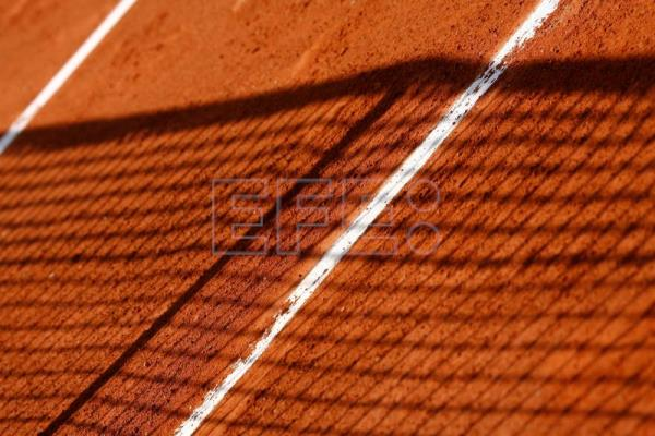 A net casts its shadow on a court at the French Open tennis tournament at Roland Garros in Paris, May 28, 2015, EPA-EFE/FILE/PHILIPPE PERUSSEAU