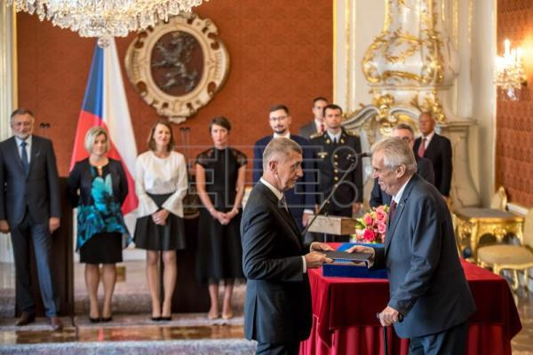 Czech President Milos Zeman (R) hands over the documents as he appoints leader of the ANO movement Andrej Babis (L) as new Czech Prime Minister at the Prague Castle in Prague, Czech Republic, June 6, 2018. EPA-EFE/MARTIN DIVISEK