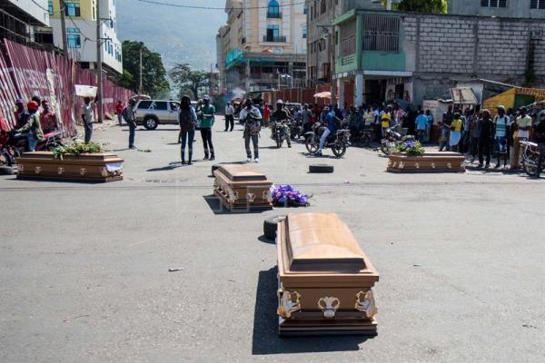 Protests during the funeral of four victims of the February demonstrations in Haiti