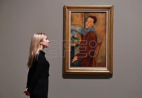 A staff member looks at Amedeo Modigliani's last Self-Portrait (1919) at the Tate Modern in London, Britain,Nov. 21, 2017. EPA/ANDY RAIN