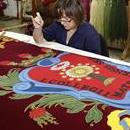 A weaver works on a tapestry at the Royal Tapestry Factory in Madrid, Spain, on October 7, 2012. EFE/David Gonzalez