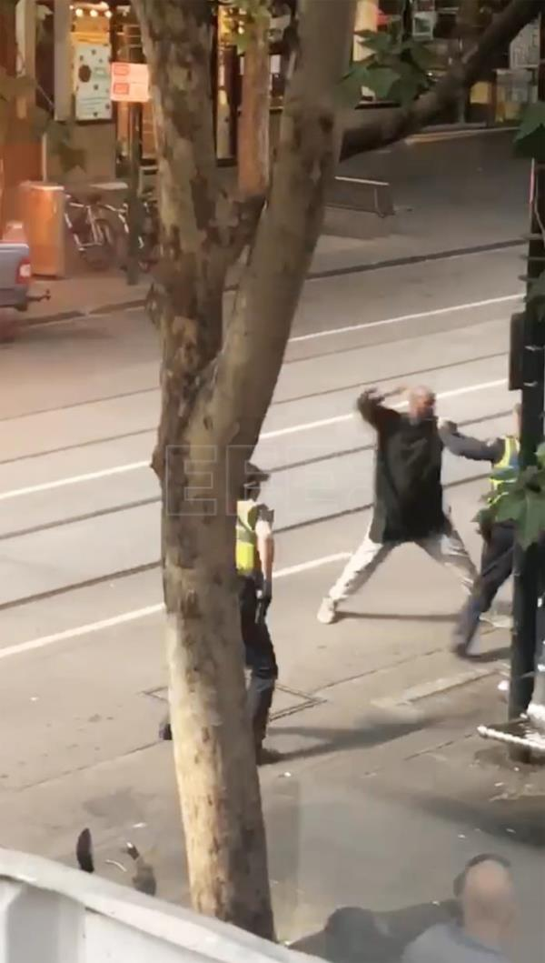 A screenshot taken from a supplied video made available to AAP shows an incident n which a man armed with a knife attacked several people on Bourke Street in Melbourne, Australia, Nov. 9, 2018. EPA-EFE/STR AUSTRALIA AND NEW ZEALAND OUT EDITORIAL USE ONLY