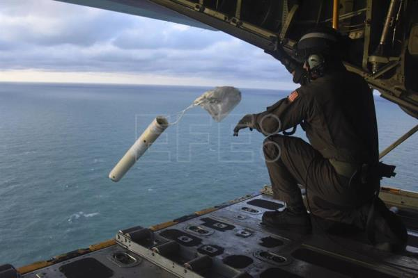 Photo provided by the US Coast Guard showing a crewmember on board an HC-130 Hercules aircraft based at Clearwater, Florida, deploying a marker buoy and viewing damage left by Hurricane Michael in the Florida Panhandle. EFE-EPA/Ashley J. Johnson/US Coast Guard/Editorial Use Only/No Sales