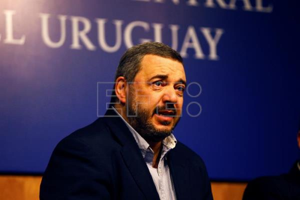 "The head of the Central Bank of Uruguay (BCU), Mario Bergara, speaks with the media during an event entitled ""The Future of Money and Financial Systems,"" a BCU-organized gathering of finance executives and information technology experts to discuss the challenges and opportunities posed by new platforms, in Montevideo, Uruguay on Sept. 20, 2017. EPA-EFE/Federico Anfitti"