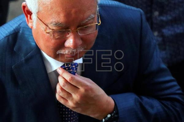 Main corruption trial against former Malaysian prime minister postponed