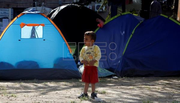A file image from Sept. 19, 2015, shows a migrant child in a Belgrade refugee camp. EPA/KOCA SULEJMANOVIC