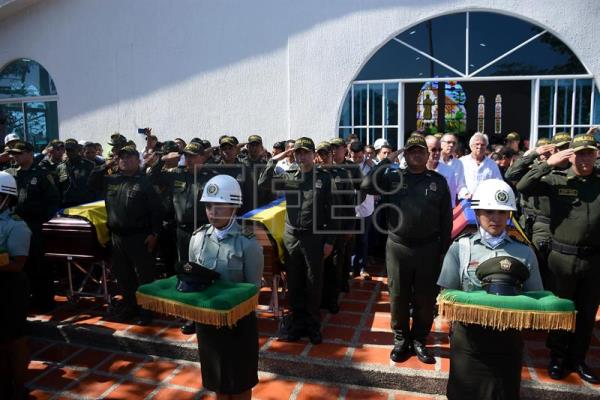 A view of the funeral of the 5 policemen who were killed in a bomb attack on the San Jose police station in Barranquilla, Colombia, on Jan. 28, 2018. The National Liberation Army (ELN) rebels claimed responsibility for the attack which left five dead and 41 wounded. EFE/Jorge Payares