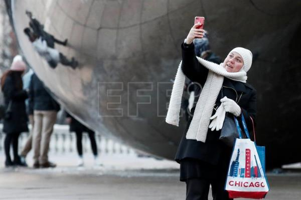 A woman takes a selfie photograph near the Cloud Gate sculpture in sub-freezing weather in Chicago, Illinois, USA, 03 January 2018. Much of the US has been blanketed with sub-freezing temperatures for more than a week and a new winter storm is predicted to hit the New England area. EPA-EFE/TANNEN MAURY
