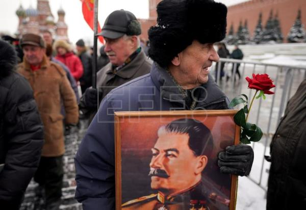 A Russian communist carries a portrait of former Soviet leader Joseph Stalin during a wreath laying ceremony at Joseph Stalin's tomb as they mark the 65th anniversary of his death near the Kremlin wall in the Red Square in Moscow, Russia, 05 March 2018. EPA-EFE/SERGEI ILNITSKY
