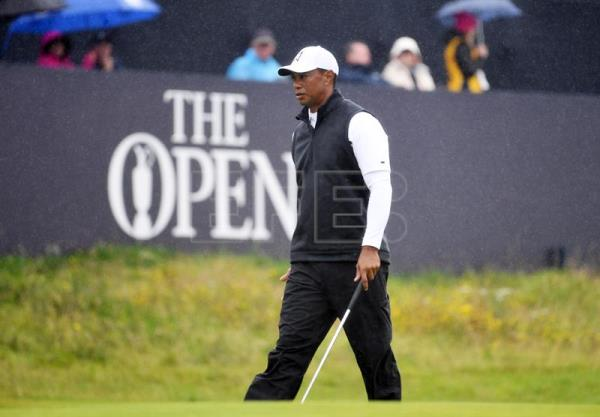 Tiger Woods shoots 1-under but still will miss cut at Open Championship