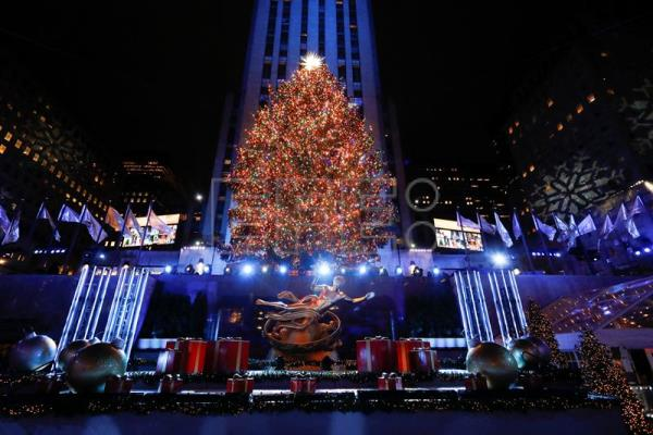 Rockefeller Christmas Tree Illuminated In New York To Kick Off