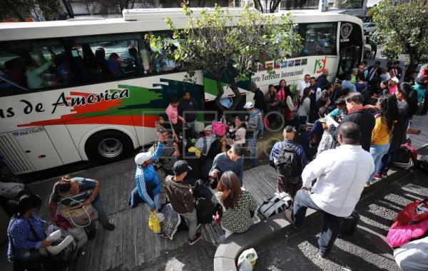 Venezuelan migrants opting for repatriation from Ecuador board buses outside Venezuela's embassy in Quito on Friday, Feb. 1. EFE-EPA/ Jose Jacome