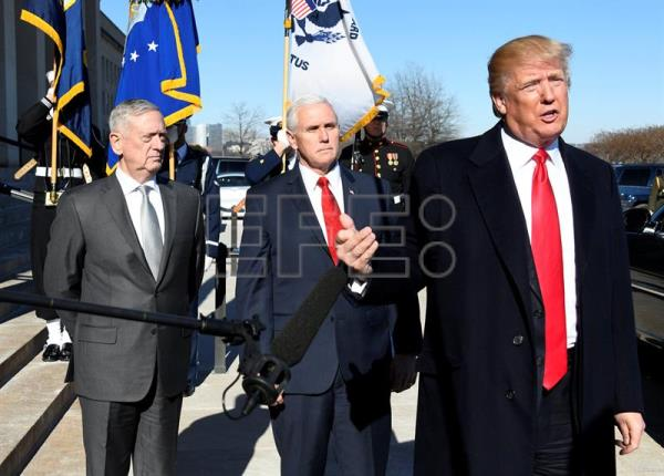 US President Donald J. Trump (R) makes a statement next to US Vice President Mike Pence (C) and US Secretary of Defense Jim Mattis (L) prior to going into the Pentagon for meetings, in Washington, DC, USA, Jan. 18, 2018. EPA-EFE/Ron Sachs / POOL