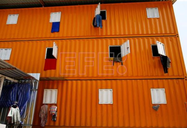Clothes hang out of the windows of refurbished shipping containers at a container village for migrant workers in Bangkok, Thailand, 18 January 2018. EPA-EFE/RUNGROJ YONGRIT