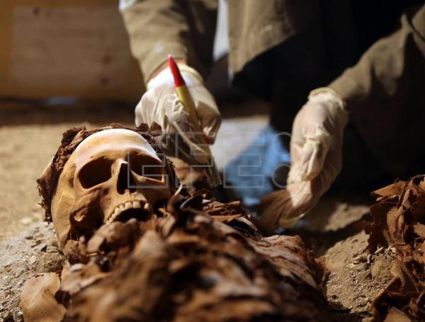 Egyptian archaeologists work on mummies at a recently discovered tomb in the Draa Abul Nagaa necropolis, Luxor's West Bank, 700km south of Cairo, Egypt, Sept. 9, 2017. EFE-EPA/KHALED ELFIQI